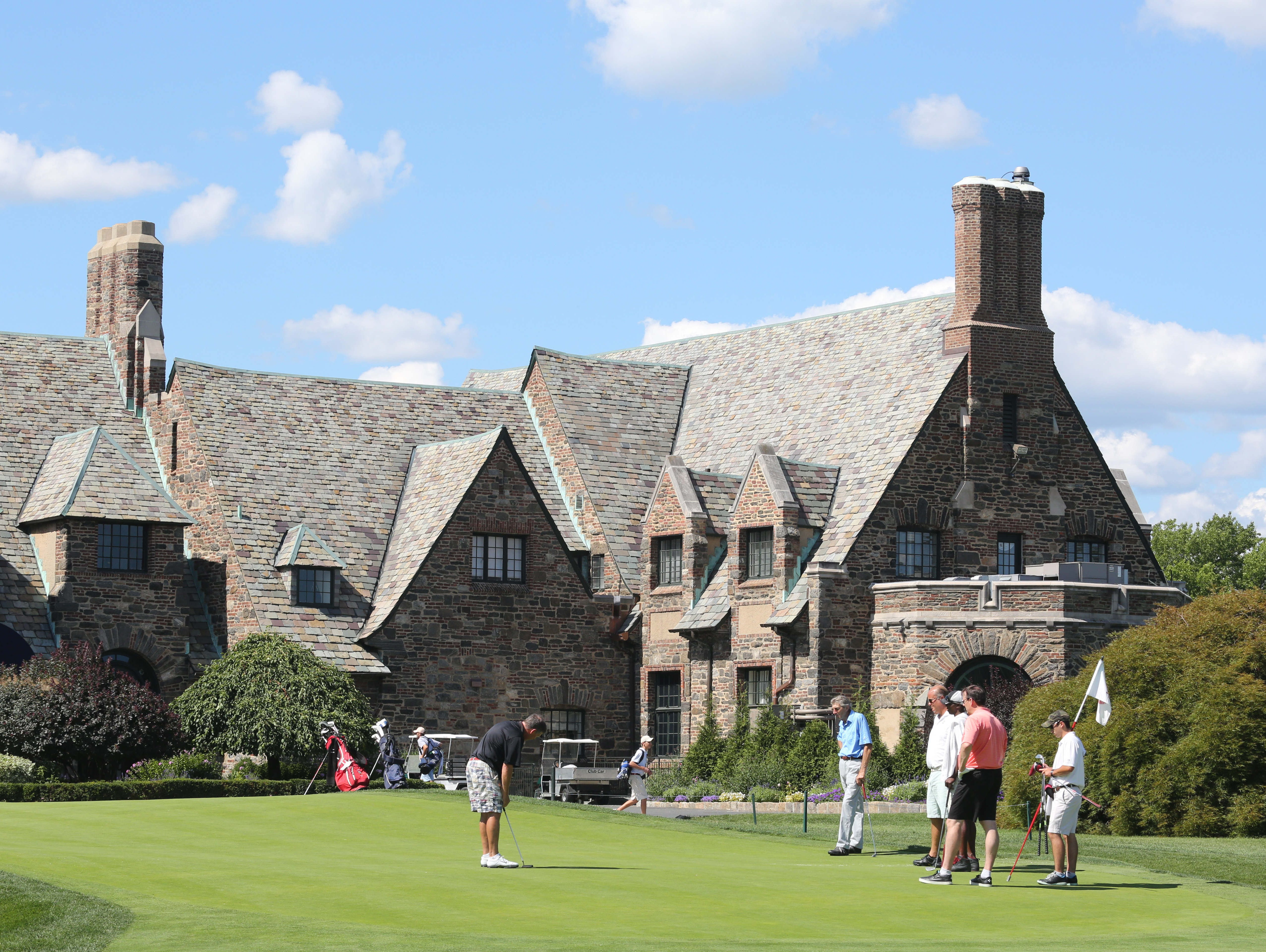 A view of the 10th green on the East Course, with the clubhouse looming in the background, at the Winged Foot Golf Club in Mamaroneck, Aug. 13, 2015. The East Course, recently restored, is hosting the USGA Four-Ball Championship next spring.