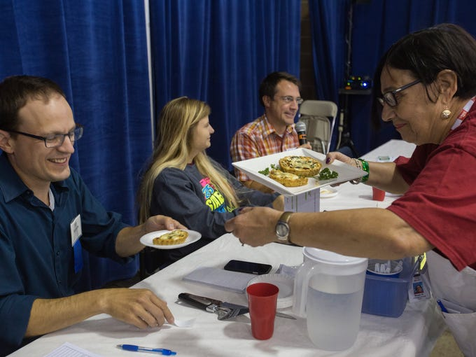 Columnist Kyle Munson is served by Rose Houston of