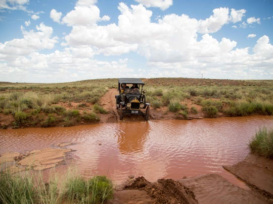 The 1915 Ford Model T team fording a stream on a ranch west of Winslow, AZ.