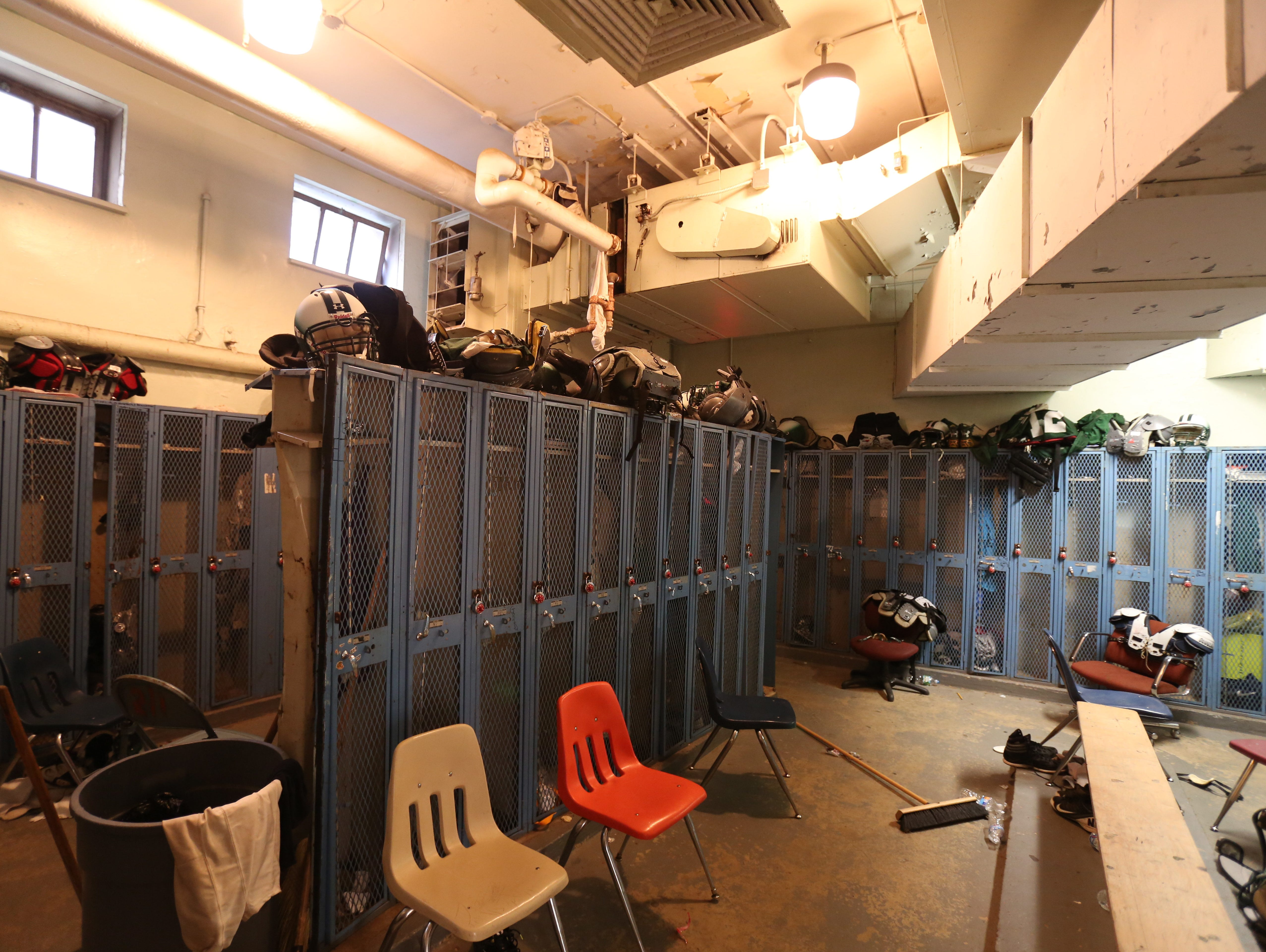 The crowded, poorly lit locker room at Gorton High School in Yonkers. Gorton would be rebuilt under a $2 billion proposal.