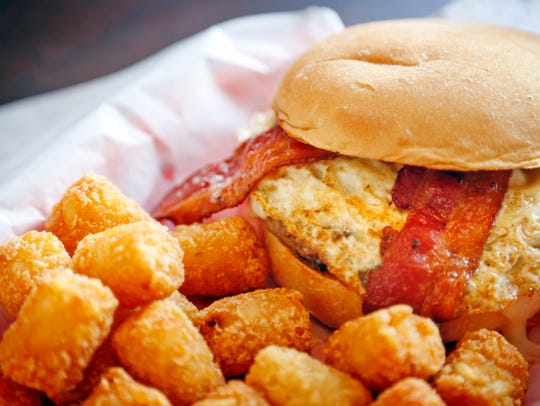 The Breakfast Burger topped with bacon and a fried