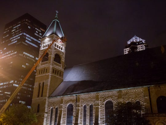 In all 36 exterior lights have been installed at St. Ambrose Cathedral to enhance its illumination at night in Des Moines, Iowa, Monday, Sept. 21, 2015.