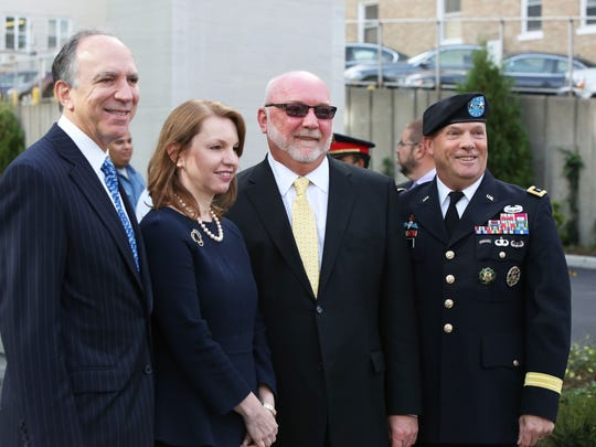 White Plains Hospital held a ceremony to mark the opening of the new main entrance and lobby, Sept. 21, 2015. Pictured are: Chairman Larry Smith, left, President and CEO Susan Fox, Vice President of Facilities Ossie Dahl and Dahl's brother Kenneth Dahl.