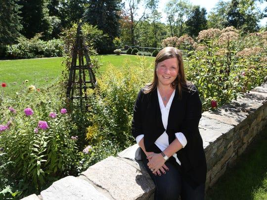 Homeowner Keryn Mathas in the rear English gardens.