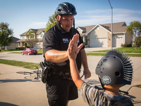 Norwalk officer Brad Criswell on bicycle patrol Tuesday