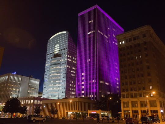Plans are in place for the Financial Center, lit up in purple, to become home to 190 upscale hotelrooms under a national brand.