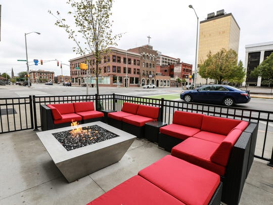 A fire pit offers a view of Delaware St. at The Tap.
