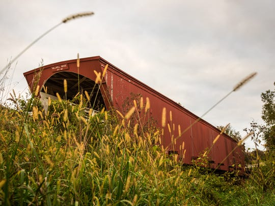 The Holliwell covered bridge in Madison County Monday, Oct. 5, 2015.