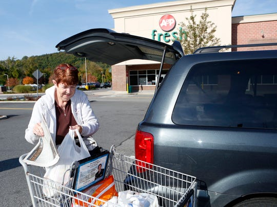 Pat Cummings of Armonk, who shops regularly at this A&P supermarket in Mount Kisco, loads her groceries into the car Oct. 8. Cummings said she also shops at the Stop & Shop in North White Plains.