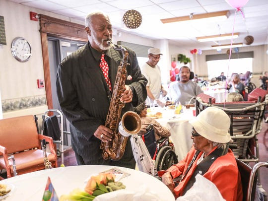 Musician Gregg Bacon serenades birthday girl Carrie Lee Braggs during her 106th birthday party at North Capitol Nursing and Rehabilitation Center.