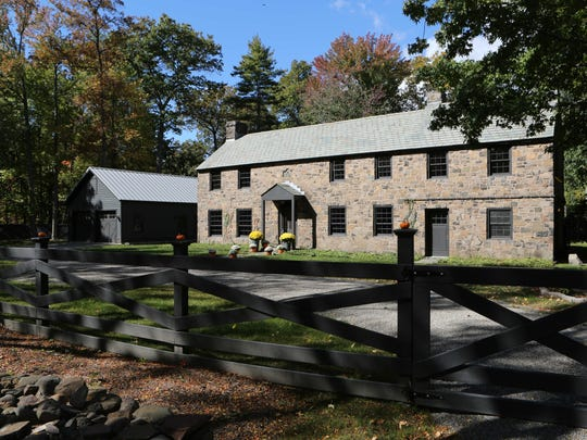 The exterior of the 1937 stone farmhouse, known as