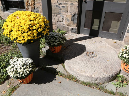 The millstone front step of the 1937 stone farmhouse,