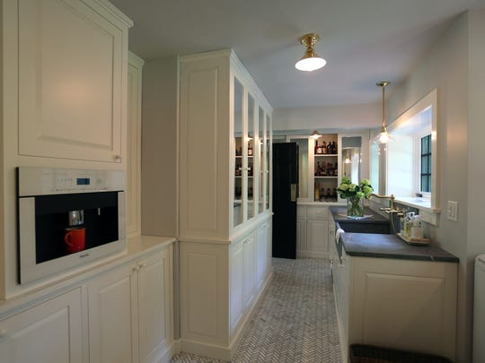 The cabinets in the new super-pantry are painted with