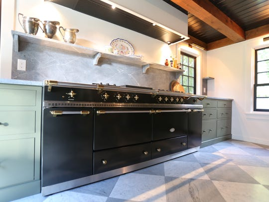 The centerpiece of the new kitchen is a Lacanche Sully 1800 stove with seven burners and four ovens.