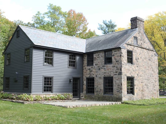 The new addition on the back of the 1937 stone farmhouse