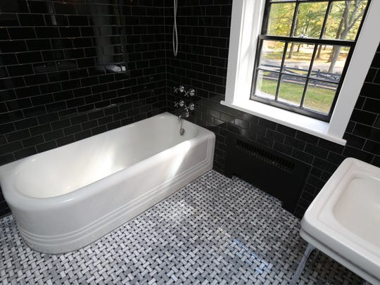 The homeowners kept the old bathroom fixtures and added new tile and flooring.