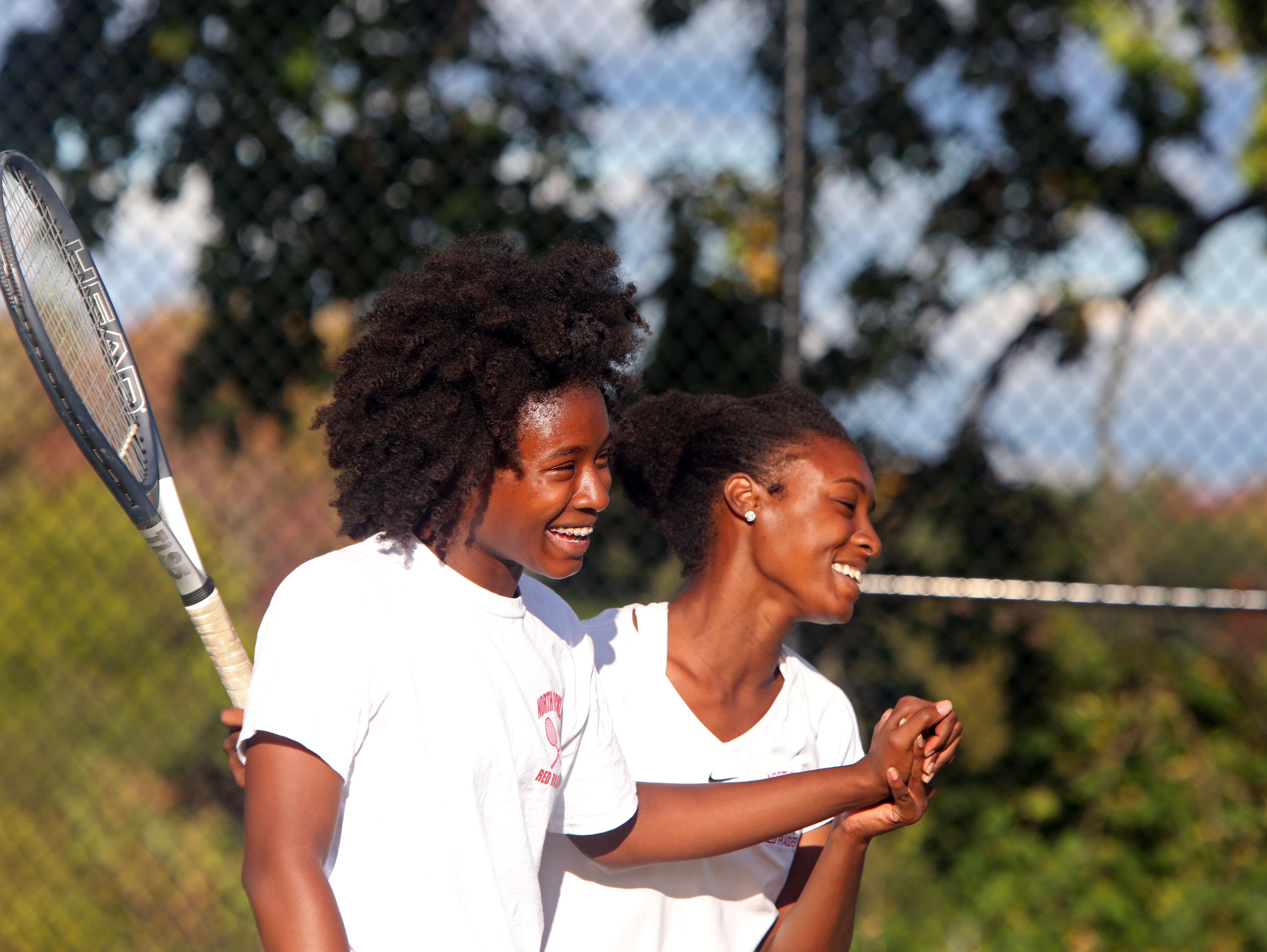 North Rockland's Akemi Dwyer, left, and sister Anika Dwyer celebrate their win in the doubles finals against Ursuline's Laina Campos and Vanessa Ciano in the Conference II tennis tournament, Oct. 16, 2015 at White Plains High School.