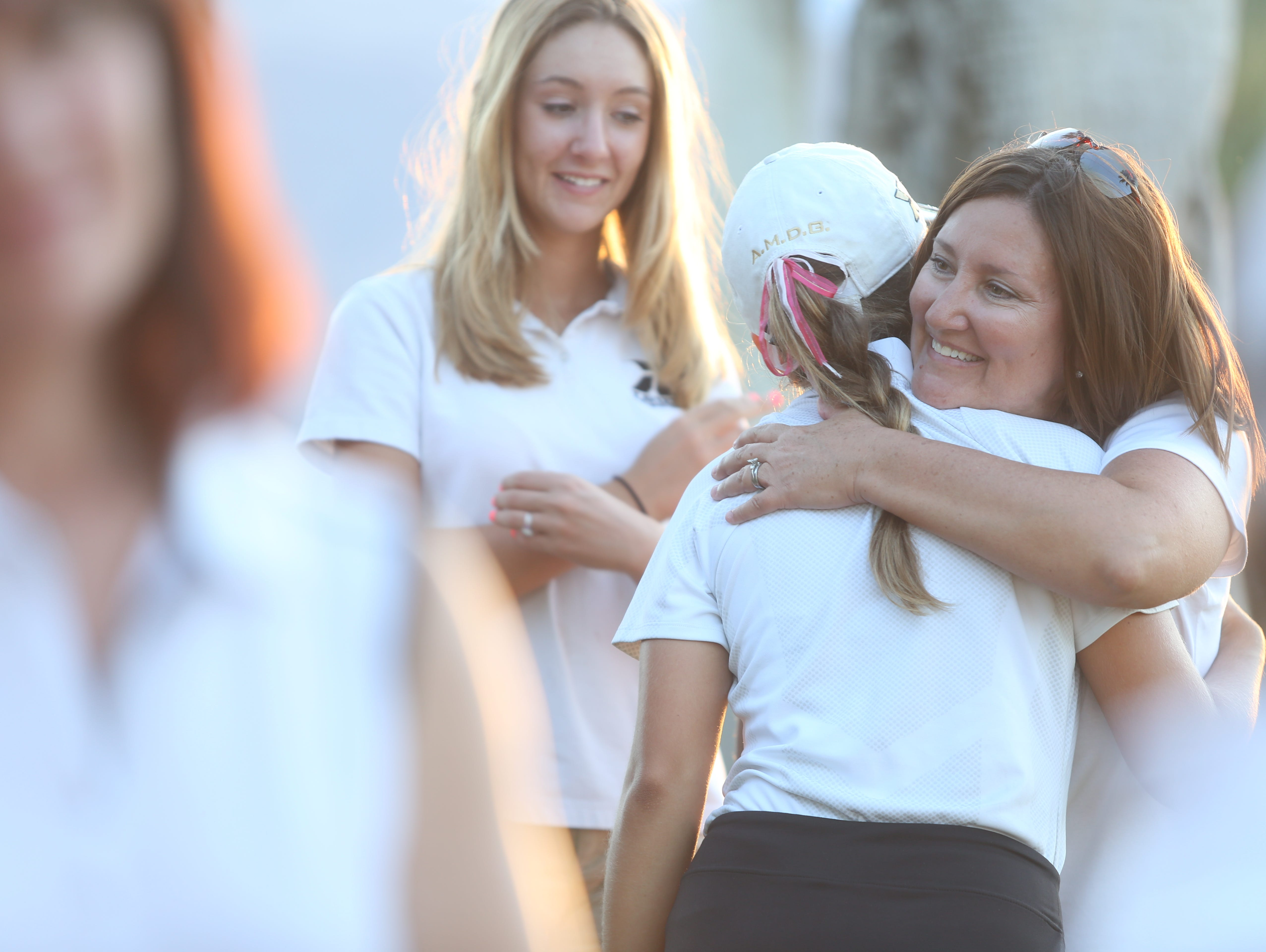 Vera Markevich, of Xavier Prep, gets hugs after becoming the DVL champion in girls golf she won her round at Desert Springs Resort Marriot in Palm Desert on October 22, 2015.