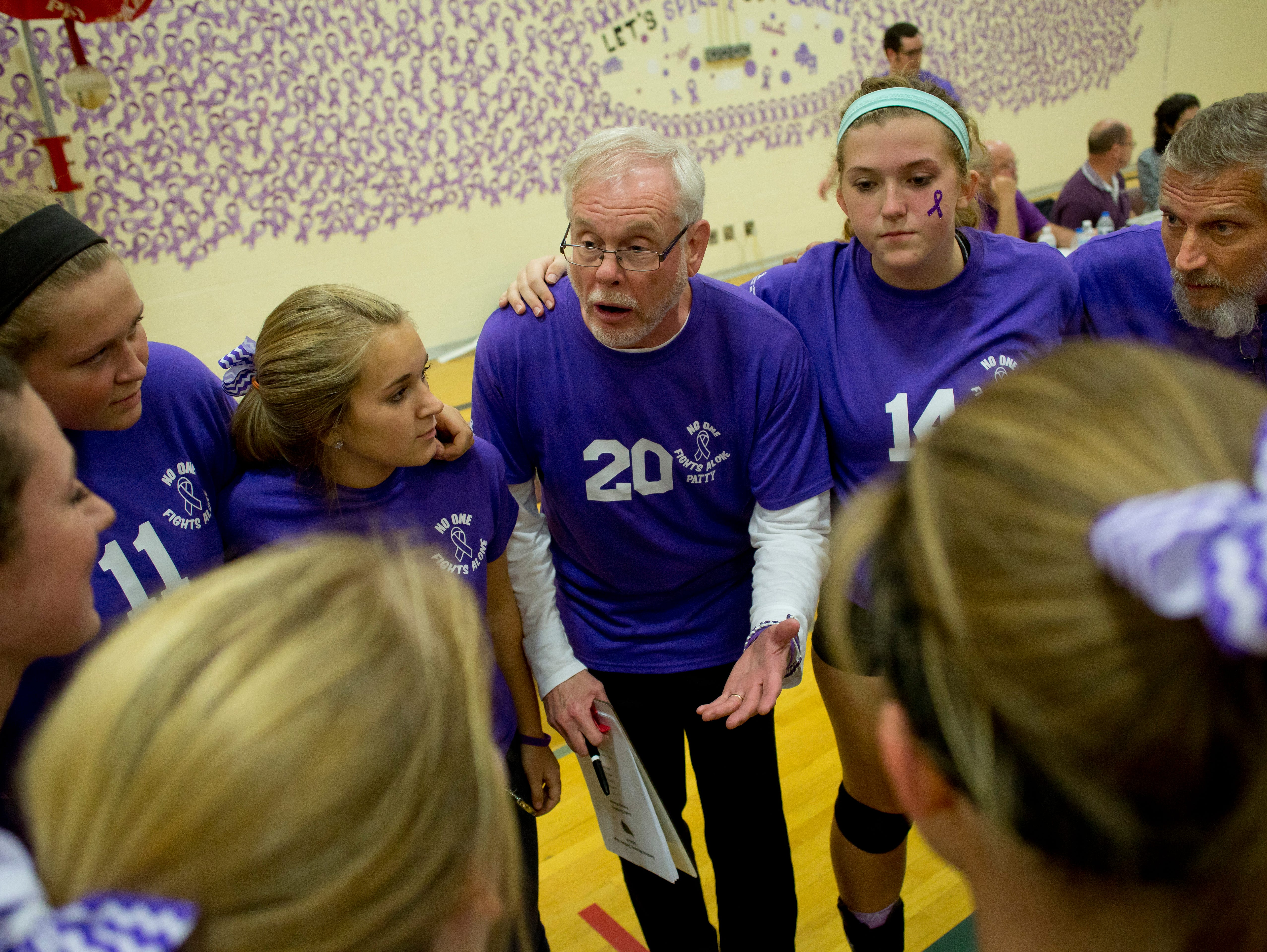 Cardinal Mooney coach Dennis Caulfield talks with players in a huddle during a volleyball game Wednesday, October 28, 2015 at Cardinal Mooney High School.