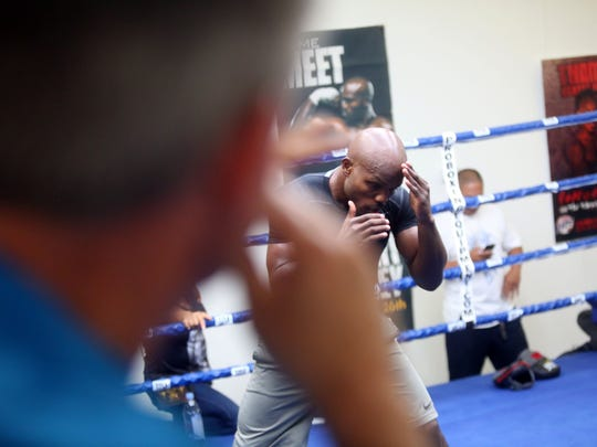 """At left, Teddy Atlas, gives instruction to Timothy Bradley Jr., during a media day workout at Bradley's gym in Indio on October 28, 2015. Bradley will fight Brandon """"Bam Bam"""" Rios on November 7, 2015 for the Bradley's WBO Welterweight Championship title in Las Vegas, Nevada."""