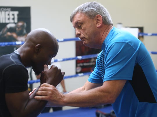 """At righ, Teddy Atlas, the new trainer of Timothy Bradley Jr., talks to him about some details in movement during a media day workout at Bradley's gym in Indio on October 28, 2015. Bradley will fight Brandon """"Bam Bam"""" Rios on November 7, 2015 for the Bradley's WBO Welterweight Championship title in Las Vegas, Nevada."""