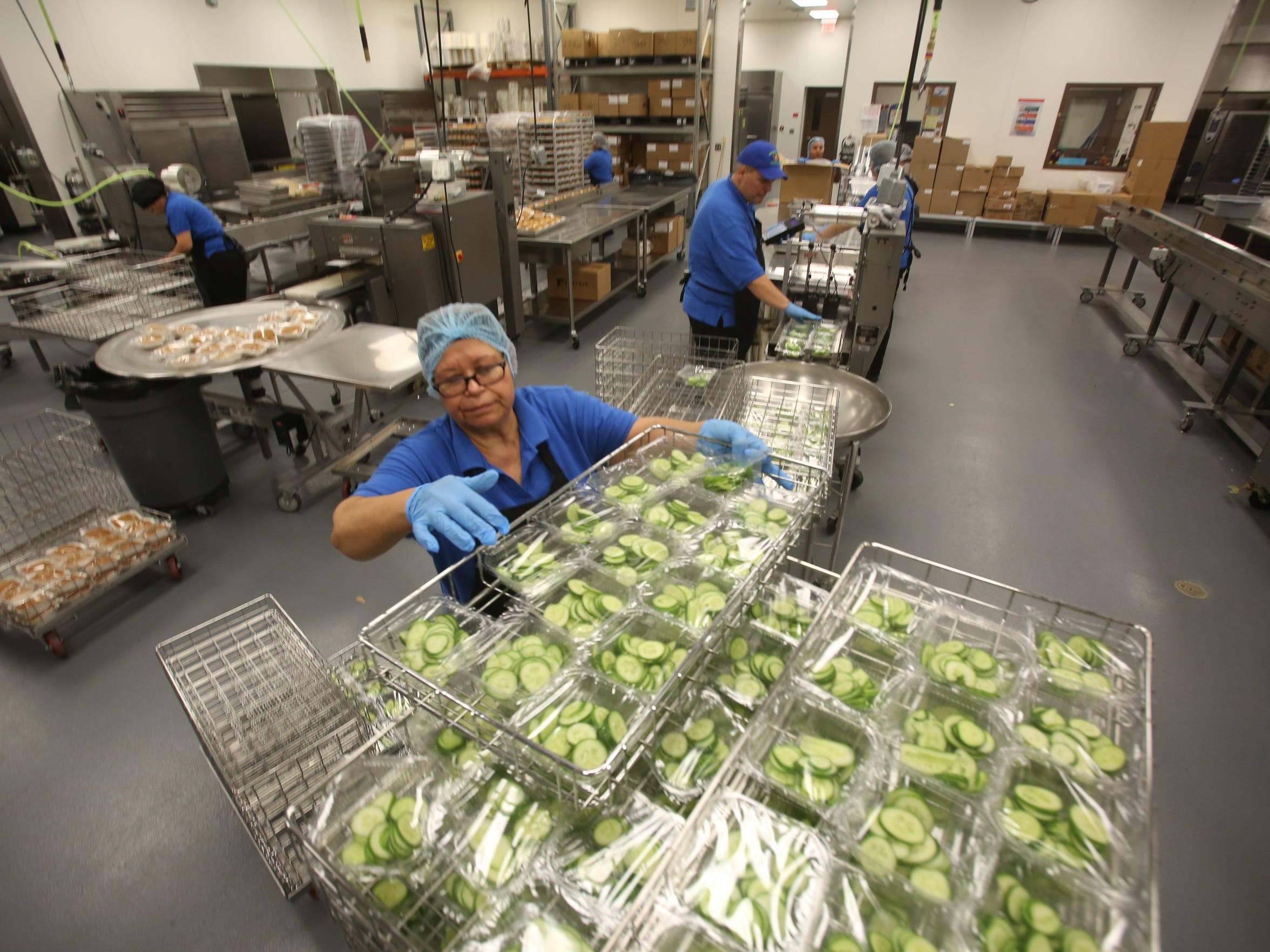 Cucumbers that were harvested in a 14 acre organic farm in Redlands are cut and prepared at the central kitchen for Palm Springs Unified School District.