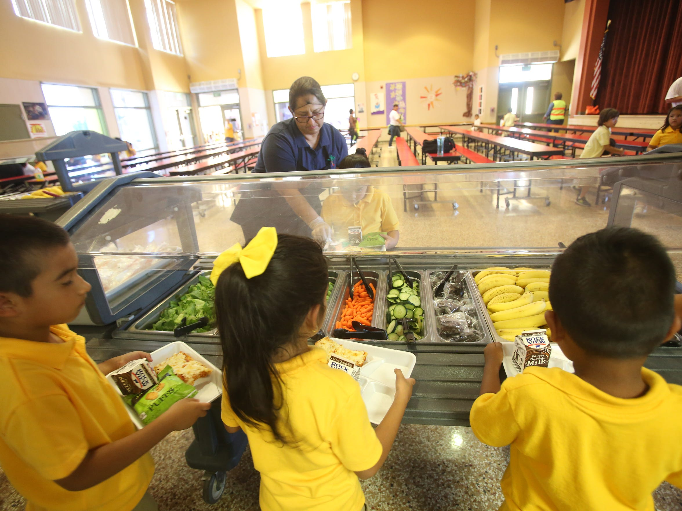 Valle Del Sol Elementary School students serve themselves vegetables  in the city of Coachella.