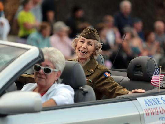 WWII veteran Anne Weston, of Palm Springs, is all smiles going down Palm Canyon Dr. during the 18th Annual  Palm Springs Veterans Day Parade on Tuesday, November 11, 2014. Weston served in England and France with Women's Army Corp. She is driven by her daughter Ana Solomon of Palm Springs.