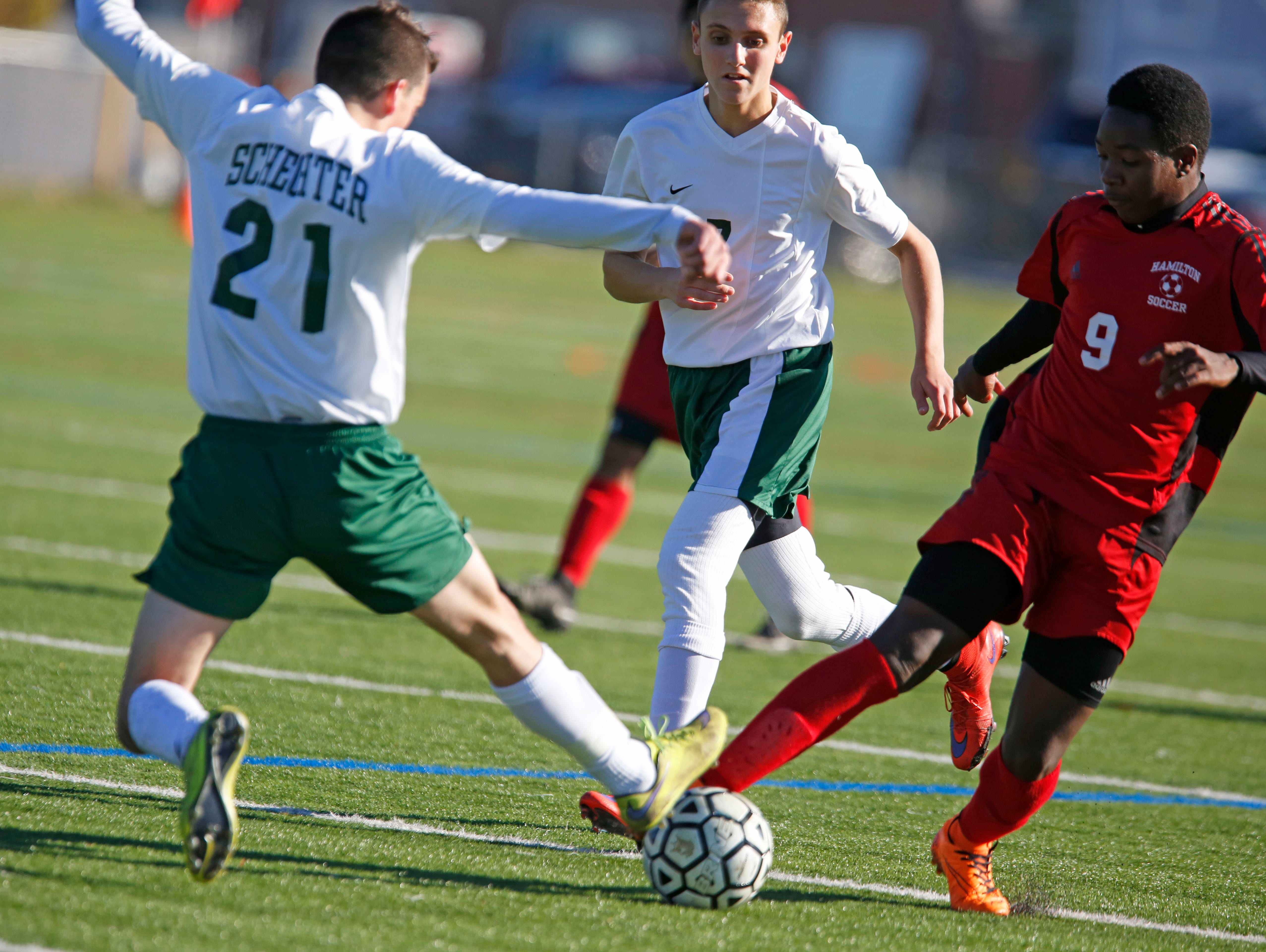 Solomon Schechter's Cameron Roth and Hamilton's Alpotchino Andre battle for possession in the Class C boys soccer final Oct. 30, 2015 at Arlington High School in Lagrangeville. Solomon Schechter won, 2-1, in overtime.