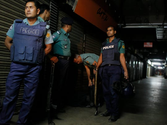 Bangladeshi security officers stand guard at the site