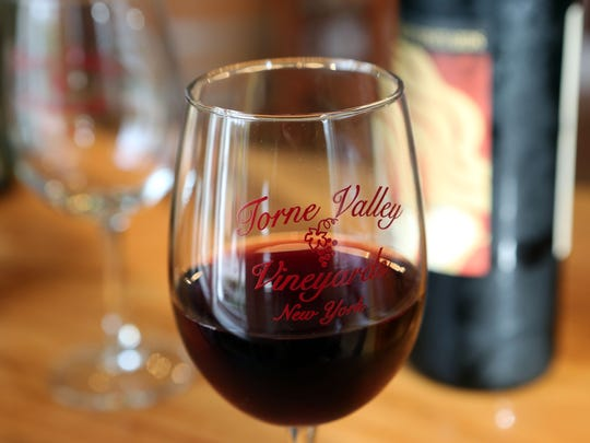 A glass of wine in the tasting room at Torne Valley
