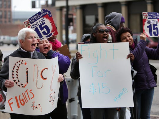 """People rallied outside of Cincinnati City Hall on Nov. 10, 2015 in support of a minimum wage hike, calling for the hourly minimum wage to be raised to $15. The rally was held in conjunction with other """"Fight for $15"""" events across the nation."""