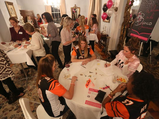 Bengals player's wives joined a group of about 60 to participate in a charity bunco night on Wednesday evening,  benefitting the Andy and Jordan Dalton Foundation's Pass It On Fund.