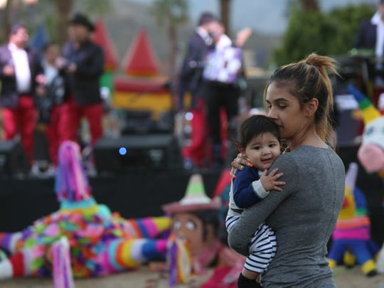 """Cathedral City host a """"Jalisco"""" festival Saturday. Ashley Martinez dances with her 6-month-old son, Caden Garcia, during the event."""