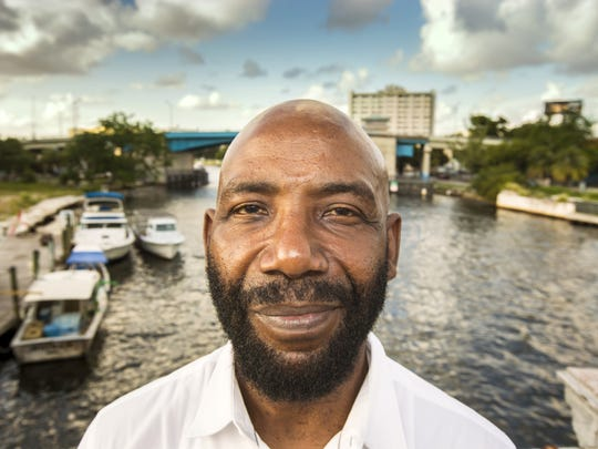 November 8, 2015: Yvens Bernard, the father of Cincinnati Bengals running back Giovani Bernard, is photographed near the spot where he landed in a small fishing boat on the Miami River in Miami. He spent several days at sea, fleeing Haiti, not knowing if he would survive.