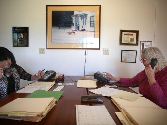 Volunteers Loretta Shur, 78, of Palm Desert, and Cleone, Miller, 84, of Palm Desert, call to check up on home bound seniors as part of the Joslyn Center Telephone Safety Net program. Photo taken on Thursday, November 19, 2015.