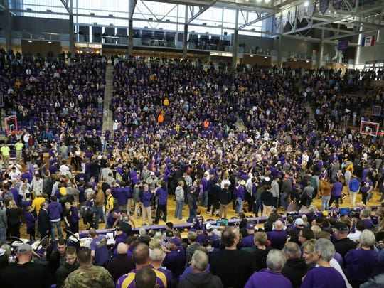 UNI fans storm the court after the Panthers beat the