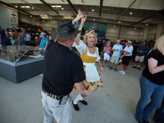 Daryl Schlicke of Calimesa dances with Jesse Walton, of Semi Valley with the band Kalifornia Krauts during the 4th annual Props and Hops festival at the Palm Springs Air Museum on Saturday.