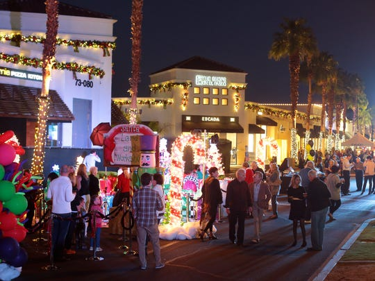 Revelers attend the festive Miracle on El Paseo party on a closed off section of El Paseo in Palm Desert on Saturday. The event benefits Bighorn BAM, a charity dedicated to cancer patient support services, breast cancer diagnostic technologies and educational scholarships.