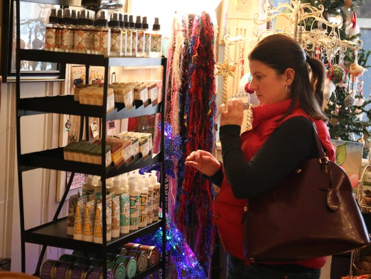 Amanda Blough looks at items Saturday at Lotus Moon Gallery and Yoga in downtown Chambersburg in this file photo.