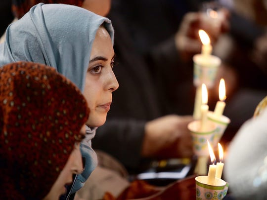 Khadija Zadeh, of Loma Linda, attends the vigil for yesterday mass shooting in San Bernardino