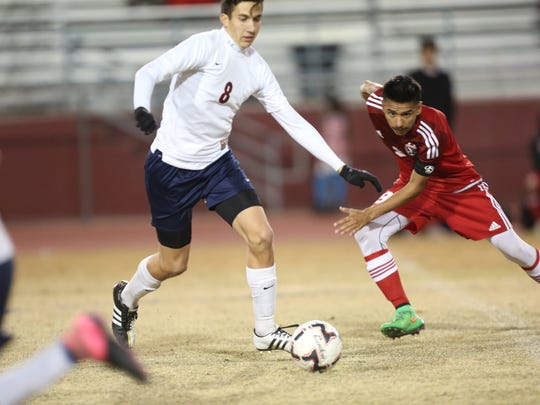 La Quinta High School's Reed Mcrae recovers a fall during a game against  Desert Mirage High School at La Quinta High School. Desert Mirage won 1-0.