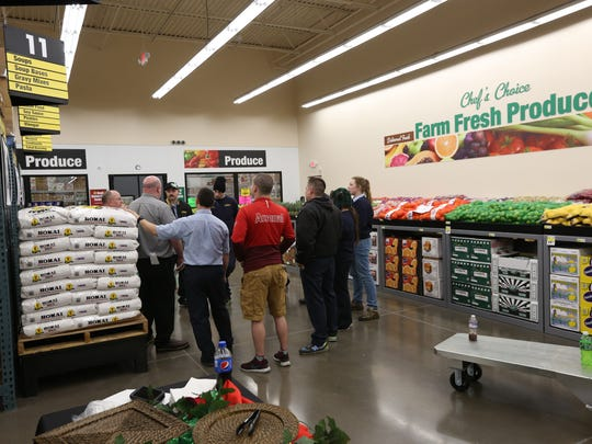 Store workers meet on Monday, Dec. 7, 2015 as they prepare to open a new Cash & Carry store in South Salem.