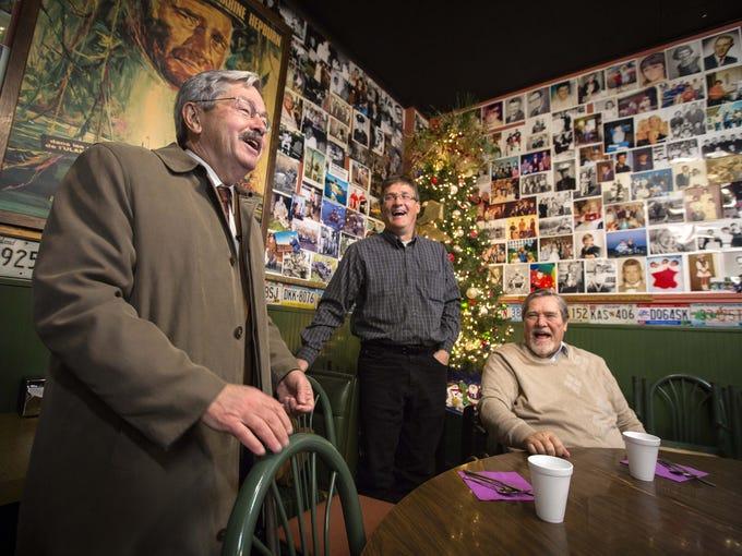 Gov. Terry Branstad, left, shares a laugh with Brad