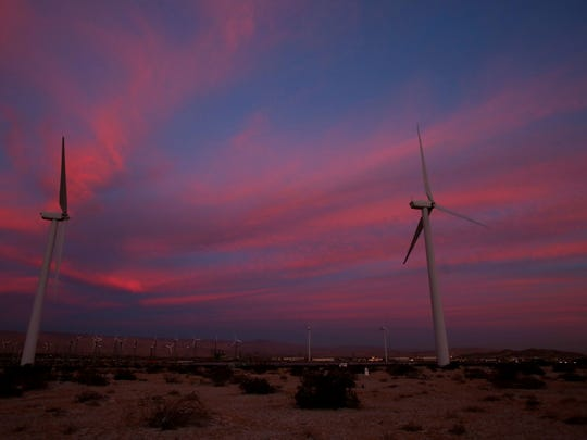Palm Springs Windmill Tours lit two of its wind turbines in changing holiday colors with energy-efficient LED lights as part of its holiday open house in north Palm Springs on Dec. 8, 2015.