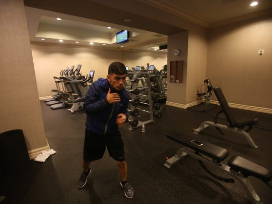 Randy Caballero finishes his last workout in his hotel room at the Manday Bay in Las Vegas, Nevada in preparation for his title defense against Lee Haskins of England on November 21, 2015 on the Canelo-Cotto undercard.