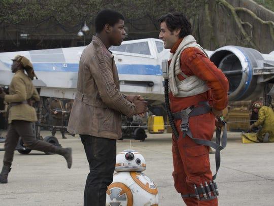 Finn (John Boyega) and BB-8 run into X-wing pilot Poe