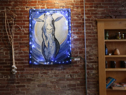 A painting of The Blue Goat's namesake is featured in the Amity restaurant.