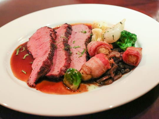 Sous Vide Tri-Tip is served with au jus, vegetables and fingerling potatoes wrapped in bacon and caramelized cippolini onions at the Silver Grille in Silverton.