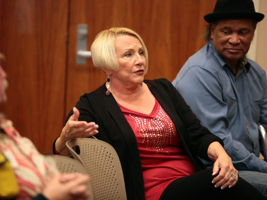 Karen Carlson, of Cathedral City, asks Raymond Nour the acting Imam of the Coachella Valley Mosque a question about the response of Muslims to ISIS during a forum on Islam on Saturday at the Cathedral City Branch Library.